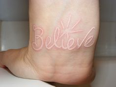get a believe tattoo in white ink