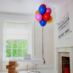 Desk supported by balloons  http://www.dezeen.com/2012/06/01/hot-desk-by-boys-and-girls/