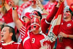 Sea of supportDanish fans cheer on their country during Denmark's Euro 2012 match against Portugal.