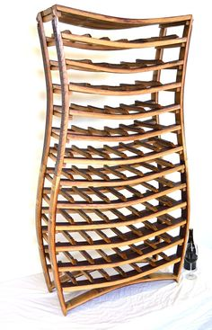 Handcrafted from locally sourced Napa wine barrels in the heart of California wine country, our exquisite wine rack collection will showcase your home or business with a rustic elegance unique to California wine culture. Available in a wide variety of designs and customizable