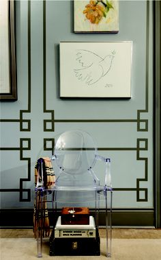 Interesting way to paint faux moldings on the wall.