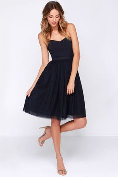 LULUS Exclusive Ballet Liaisons Strapless Navy Blue Dress: Learn all the right moves to wow and impress for your next party in this dress. This cute strapless dress starts with a sweetheart bodice, and a no-slip strip for extra security. Hidden boning gives the woven bodice flattering form above the fitted waistline, where the layered tulle skirt gathers and flares to a mid-length. Exposed gold zipper on back. Adjustable spaghetti straps included. Fully lined. Dry clean only XS $56