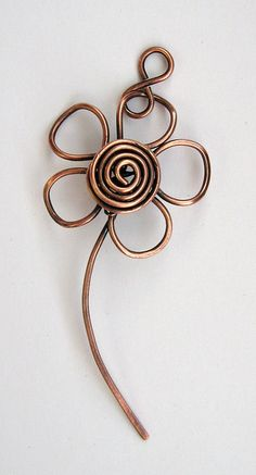 Marguerite pendant by Louise Goodchild: Copper wire daisy, shaped, oxidised and polished. This would be so cute in the garden made MUCH larger. Cute and dainty