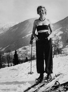 Ça fait du bien, le soleil!  Vintage photo of skier in bandeau top, 1936.