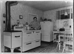 1940-1946...Portrait of America. No. 36. Rural electrification in the U.S. The electric range or stove in this American farm kitchen eliminates the need of building fires, carrying fuel and emptying ashes, thus allowing the housewife at least ten more hours per month for other tasks. (oh, happy day)
