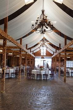 Rustic fall vineyard wedding reception at the Stable at Bluemont Vineyard in Virginia just outside of Washington, DC.  Fall colors and jewel tones.  For more see:   http://jalapenophotography.com/bluemont-vineyard-wedding-photos/