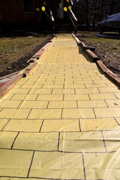 Yellow table cloth with sharpie; yellowbrick road for trunk or treat