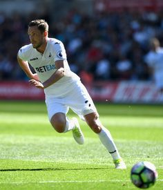 08474fb99 Gylfi Sigurdsson of Swansea in action during the Premier League match  between Swansea City and Stoke