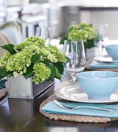 Lime green hydrangeas and blue tableware make a pleasing combination. - Traditional Home ®/ Photo: Emily Followill