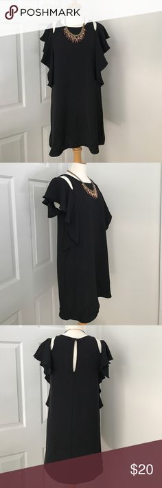 Everly NWOT black dress with shoulder cut outs Everly NWOT black dress with shoulder cut outs and ruffle detail.  Size S. Everly Dresses