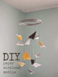 paper airplane mobile tutorial - {from Knee Deep in the Baby Pool}
