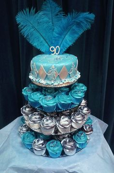 I loved making this for an old friend. Her Gran and Grandad were 90 and they are both dancers. The brief was a Cupcake tower with blue and a ballroom theme. I put the dancing couples around the sides of the topper cake