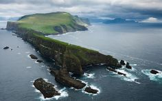 """Mykines.  Where is it? Faroe Islands in the north Atlantic Ocean.  What is it like? """"Its location far out in the Atlantic and its wealth of birdlife are a strong draw for visitors, who find that the island exudes a powerful atmosphere of real vitality and vibrant life.""""  Roger Lovegrove."""