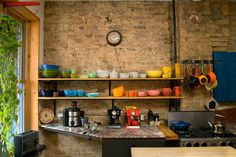 Dan's Apartment of Artful Assemblages House Tour | Apartment Therapy.  Colorful open shelving