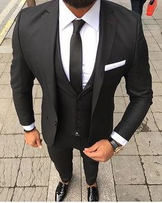 Classic black and white suit combo that will never go out of style. When you're not sure what to wear go to this as an example #suit #blackandwhite #mensfashion #menswear #timelesd #menstyle #monochrome