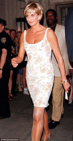 Wearing a simple but striking cream silk mini, this is carefree, post-divorce Diana at her...