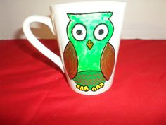 Check out this item in my Etsy shop https://www.etsy.com/listing/464581463/handpainted-coffee-cup-mug-owl-glassware