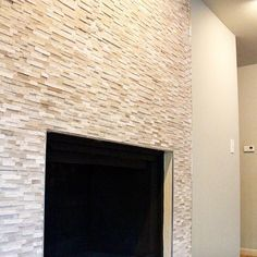 Loving the tile work on this fireplace! Do you like it?  #RealEstate #FlippingHouses #AndrewCordle #AndrewCordle