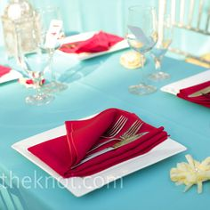 Red napkins and white chargers popped against the turquoise table linens. Turquoise Table, Red Turquoise, Teal, Aqua Wedding, Wedding Colors, Pink Table, Wedding Table Settings, Place Settings, Wedding Inspiration
