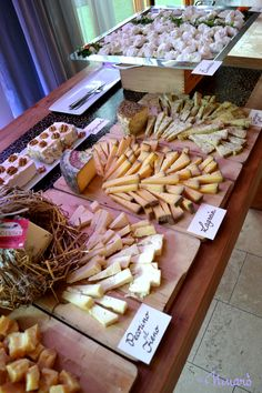 Cheese Buffet - seems more grand with each kind on a different board.