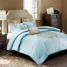 The Lexington comforter adds an elevated look to your bedroom with soft blue vertical stripes to create texture and a large damask print in the middle. A soft gray covers the reverse side of the comforter. Comes with two decorative pillows with the same gray damask print. Made from a lightweight polyester charmeuse and is machine washable for easy care.