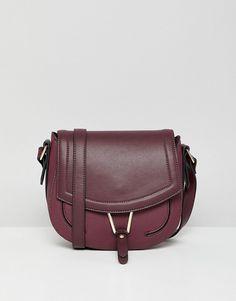 Accessorize Phillipa burgundy cross-body saddle bag at asos.com 3d292ccee94e9