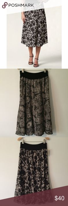 Coldwater Creek Inkscape reversible skirt sz 8 Coldwater Creek Inkscape reversible skirt. NWT! Size: 8. Length: 30.5 inches. Waist: 14.5 inches. Rayon/spandex black waistband. Reversible skirt. Floral side and striped side. Tan/cream & black. Flowy and fun. Brand new with tags. Coldwater Creek Skirts Midi