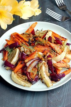 Spicy roasted fennel and carrots is a simple but striking dish that comes together in about 30 minutes. Enjoy it straight up, as a side or in a salad. Baked Fennel, Roasted Fennel, Roasted Vegetables, Veggies, Fennel Recipes, Vegetable Recipes, Vegetarian Recipes, Cooking Recipes, Healthy Recipes