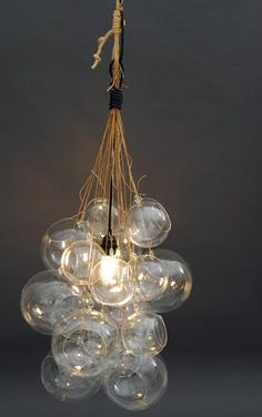 DIY: glass orb cluster light/ A cheaper way-glass christmas ornaments in different sizes, just make sure that the wattage of the bulb is low(so glass doesn't break). I would spray the gold ornament tops with Krylon's, Looking Glass spray paint. Bubble Chandelier, Globe Chandelier, Crystal Chandeliers, Pendant Lamps, Globe Pendant, Pendant Lights, Pendants, Cluster Lights, Diy Light Fixtures