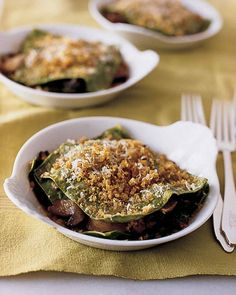 Individual lasagnas of spinach pasta are layered with mushrooms, breadcrumbs, and cheese.