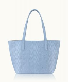 The popular, take-everywhere tote in Full-Grain Embossed Python, features full…