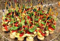 Antipasto Sausage Skewers - Italian style chicken sausage, artichoke hearts, roasted red pepper, sun dried tomato and basil leaf.