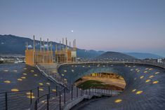 The slate-covered roof has an organic profile informed by the outline of the surrounding mountains. David Chipperfield Architects, Public Theater, Through The Roof, Roof Structure, Architecture Student, Chinese Architecture, Roof Plan, Museum Of Contemporary Art, Natural Garden