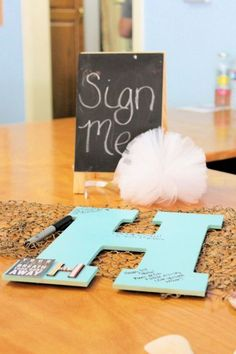 Baby's initial serves as an autograph book. See more first boy birthday and party ideas at one-stop-party-ideas.com