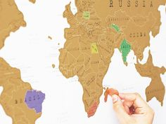 World Scratch Map. A classic world map where the continents are topped with a scratch-off foil surface so you can show off the places you've visited.