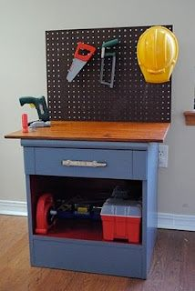 A 3 dollar nightstand transformed into a childs workbench!!  Love it!!