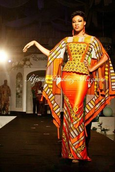 Royal. Adore the detail, fit, material....Very African influenced to me...Goddess like