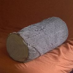 Chenille log pillow for storing guest bedding