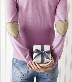 "Wear your heart on your sleeve. Transform any sweater into a romantic fashion statement by tweaking store-bought elbow patches ($7.98 for two; mjtrim.com).   Simply cut a heart-shaped pattern out of scrap paper (ours measured approximately 4 1/2"" x 4 1/2""), then use that pattern to cut out a heart from each patch. Lastly, hand-sew the patches to the backs of your sleeves with a simple blanket stitch in a darker shade of thread.   - CountryLiving.com"