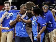 Larry Hill, 26, of Oklahoma City, second from left, reacts after hitting the $20,000 half-court shot during Game 1 in the first round of the NBA playoffs between the Oklahoma City Thunder and the Houston Rockets at Chesapeake Energy Arena in Oklahoma City, Sunday, April 21, 2013. Oklahoma City won, 120-91. Photo by Nate Billings, The Oklahoman