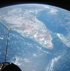 """The Indian subcontinent as seen from Gemini 11. Pete Conrad's and Dick Gordon's mission was the highest ever in Earth orbit -- reaching up to 850 miles at one point. The Gemini astronauts captured hundreds of scenes of the planet. Says Robinson, """"These are our first comprehensive looks at the Earth in color from space."""""""