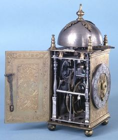 German, Late C16th. Wall clock with engraved gilt-brass case and a later silver chapter-ring; verge escapement with balance; weight-driven; striking-train (hours only).   TRAIN-COUNTS. Going. Gt wheel 70 2nd wheel 40/10 3rd wheel 42/8 Contrate wheel 26/6 Crown wheel 11/6  Gt wheel arbor squared to take pinion of 12 to drive hour-wheel 72.  Striking. Gt wheel 60 Hoop wheel 60/10 Pin wheel 48/6 Fly 6  Gt wheel arbor squared to take pinion of 12 to drive count-wheel 78.  British Museum