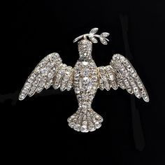 DOVE BROOCH Country: England Period: 19th Century An antique gold and silver Dove Brooch with brunch of olive branch fully set with c. 144 mine cut Diamonds. England, c. 1850