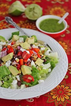 Mexican Chopped Salad with Lime Cilantro Dressing Recipe - this gorgeous healthy salad is full of textures and color ~ black beans, roasted corn, avocado, red bell peppers and red onion ~ http://jeanetteshealthyliving.com