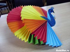 This page includes a lot of folding paper crafts for kıds,preschoolers,kindergarten. folded paper caterpillar craft for kids paper toys for kids paper folding skills how to make origami for kids easy origami: models especially for beginners and kids Creative Arts And Crafts, Paper Crafts For Kids, Craft Activities For Kids, Hobbies And Crafts, Fun Crafts, Diy And Crafts, Decoration Creche, Peacock Crafts, 3d Origami