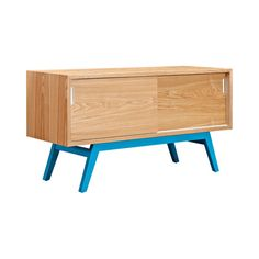 With a beautiful natural wood veneer and solid ash wood base, this Menken Credenza boasts a stylish mid-century–inspired silhouette. Each sliding door reveals a separate shelf space, perfect for storin...  Find the Menken Credenza in Natural, as seen in the The Blueprint of Modern Design Collection at http://dotandbo.com/collections/the-blueprint-of-modern-design?utm_source=pinterest