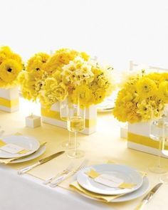 navy blue table cloths, white vases, yellow flowers maybe?