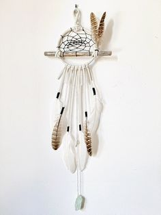The Eastern Screech Owl Dreamcatcher - Natural Wood Branch Wall Hanging Dream Catcher, Leather Lace with feathers, Hanging Gemstone Crystal by TheDreamerWeaver on Etsy https://www.etsy.com/listing/263508299/the-eastern-screech-owl-dreamcatcher