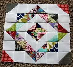 Image result for half square triangle scrap quilts