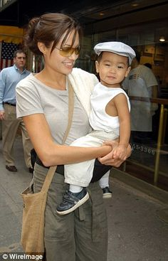 Young mom: Though she recently admitted that there was a time when she thought she would never be a mother, she adopted first son Maddox (pictured) in 2002 - at the age of 26